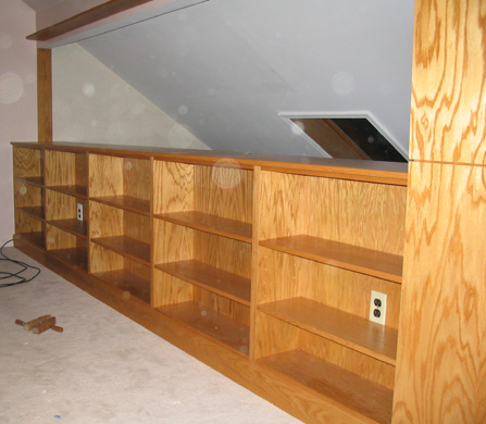Built-in golden oak bookcase