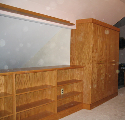 Built-in golden oak bookcase and cabinets