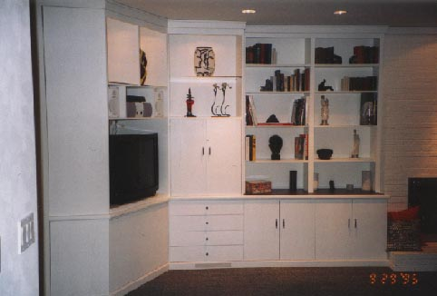 Built-in white lacquered oak wall unit / entertainment center / bar