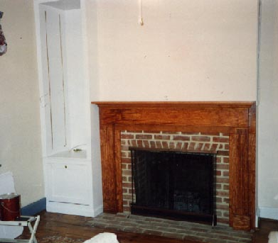 Buit-in cabinet and pine fireplace surround