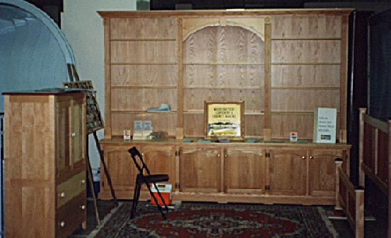Birdseye maple and rosewood armoire, Pickled oak wall unit, Curly maple and rosewood bed