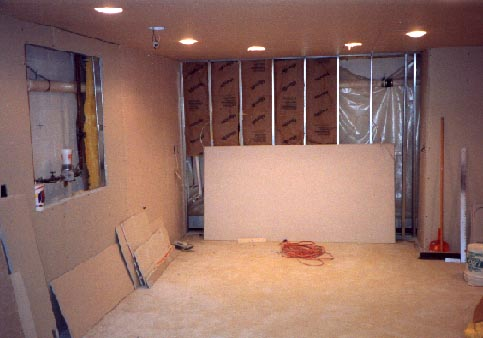 Sheetrock installation in finished basement