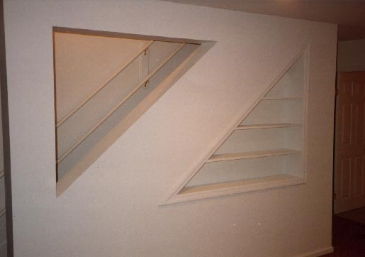 Finished built-in bookcase under stairs to basement